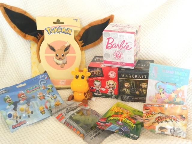 a photo showing an order from Toys for a Pound, including blind boxes, funko, eevee ears and confetti