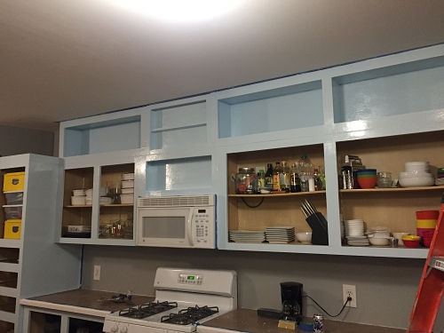 blue cabinets with gray walls