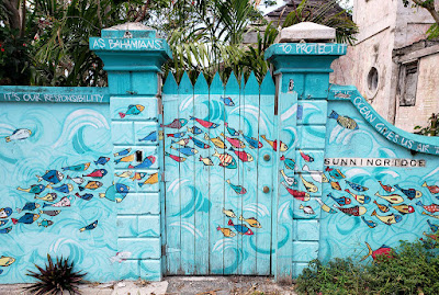 Mural of fish swimming on wall