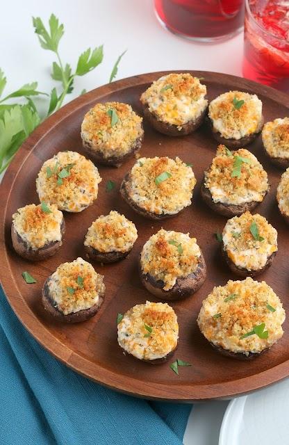 Cheesy Garlic Stuffed Mushrooms on wood platter