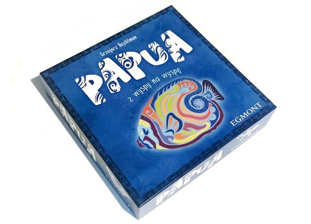 na zdjęciu pudełko gry papua w kolorze