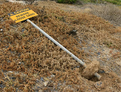 Funny Signs beware loose sand
