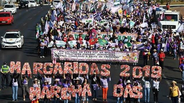 Tens of thousands of women march in Brasilia against President Jair Bolsonaro in Brazil