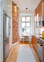 Accent wall for narrow kitchen ideas with brick wall also cool wood cabinets and white top