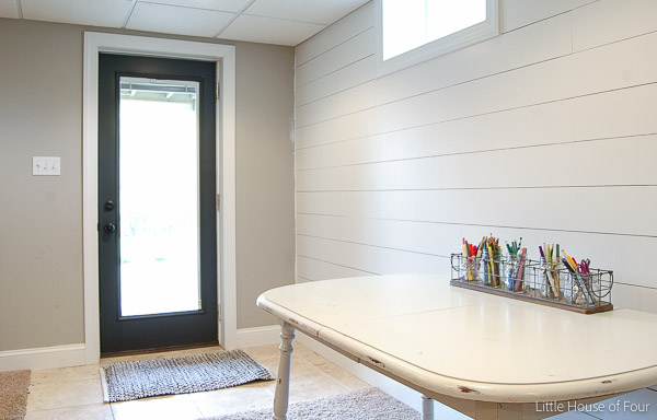 Brighten up your basement with a gorgeous plank wall! Littlehouseoffour.com