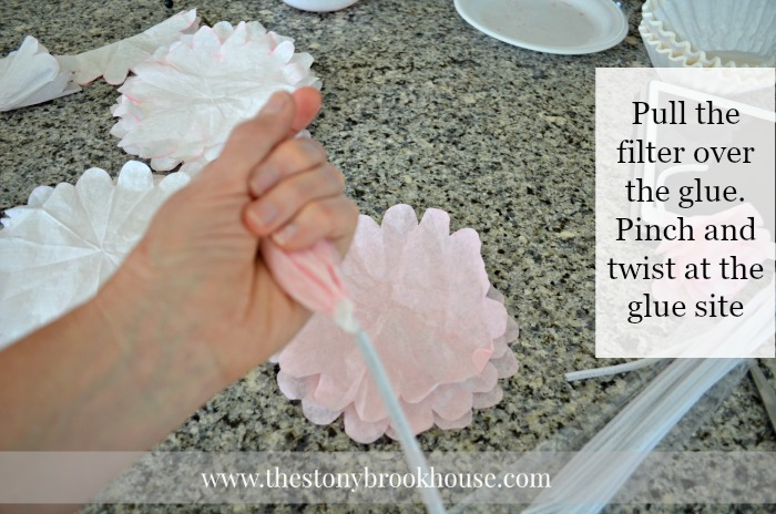Pull coffee filter over glue and pinch closed