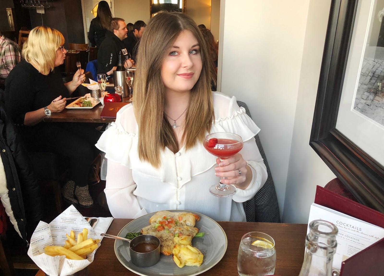 Grace inside a restaurant drinking a strawberry Daiquiri