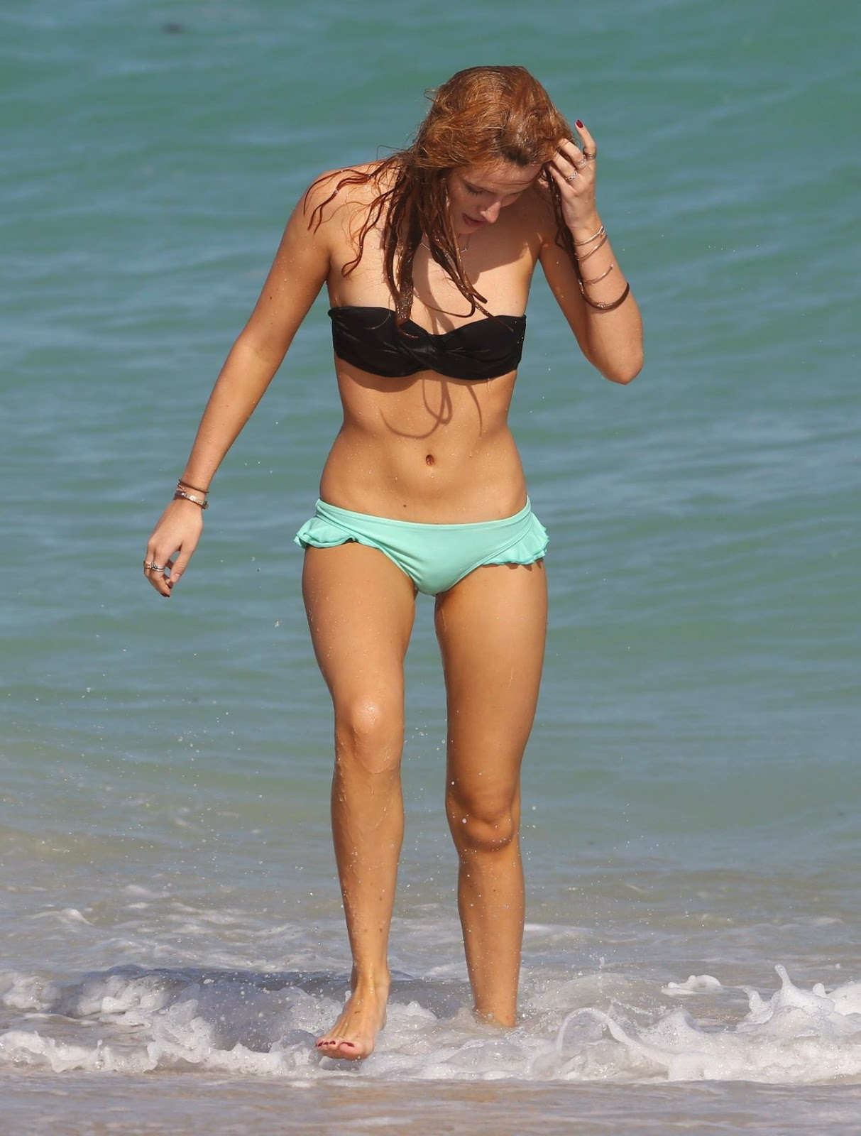 Bella Thorne flaunts bikini body in a strapless bikini at Miami beach