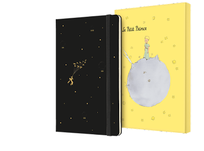 Agenda de El Principito. La agenda es negra con detalles dorados y tiene una caja amarilla para guardarla