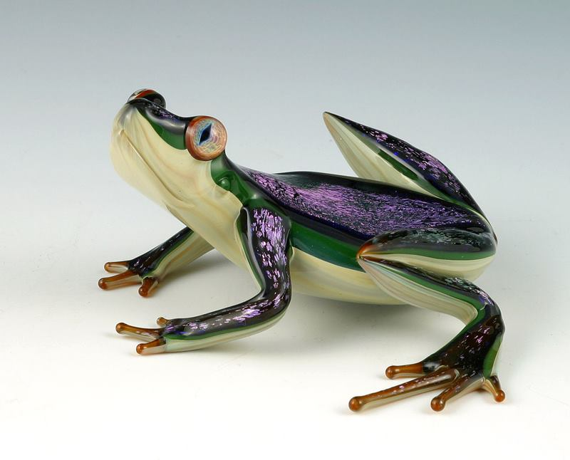 Oregon-based artist Scott Bisson, Scott works with both blown and flameworked glass, both of which require very different skills. His flameworked pieces, such as frogs and geckos, are intricate and lively. Using a blowpipe, Scott brings together his skill, knowledge, and intensity to produce larger pieces such as paperweights and pitchers.