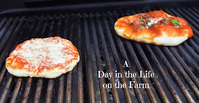 pizzas on grill