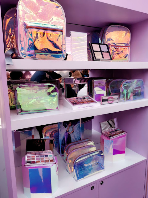 THE HUDA BEAUTY LIMITED EDITION MERCURY RETROGRADE BACKPACK AND COSMETIC BAG AT THE HUDA BEAUTY POP EVENT IN LONDON