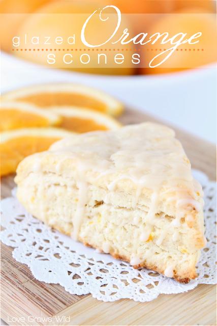 Glazed Orange Scones - a delicious citrusy scone drizzled with an orange vanilla glaze! at LoveGrowsWild.com