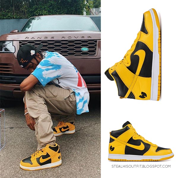 Travis Scott in yellow Nike high top sneakers