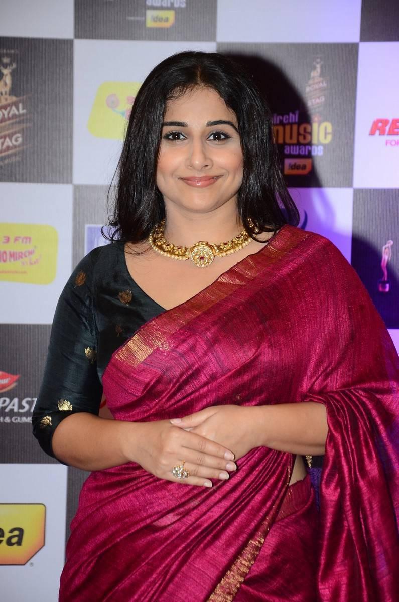Vidya Balan Smiling Stills In Red Saree