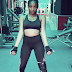 Simi shows off banging bod during workout