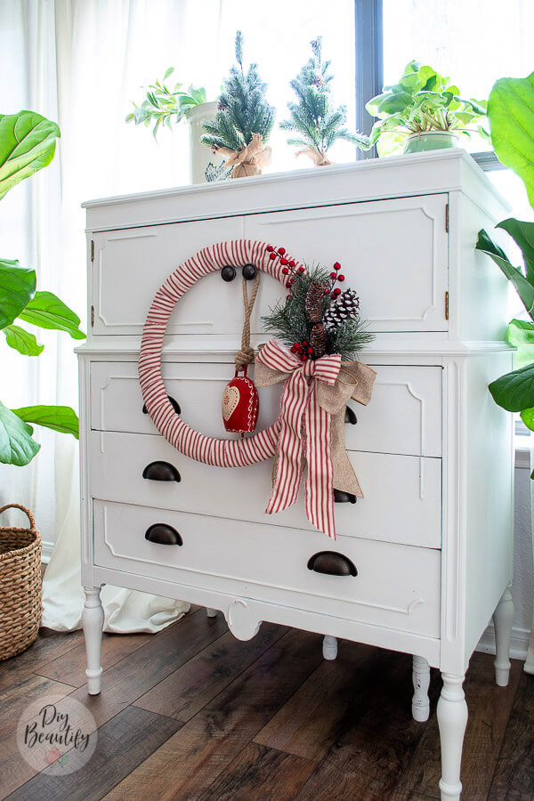 white cottage dresser with Christmas wreath