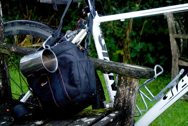 close up carrying camera and tea mug