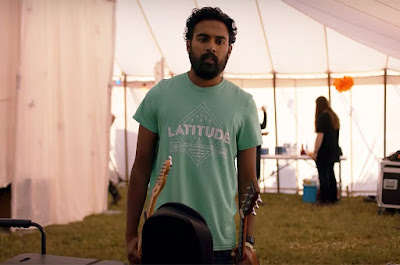 Jack Malik, played by Himesh Patel, looks depressed after a terrible gig at the Latitude festival in Yesterday, Danny Boyle's latest film about The Beatles never existing