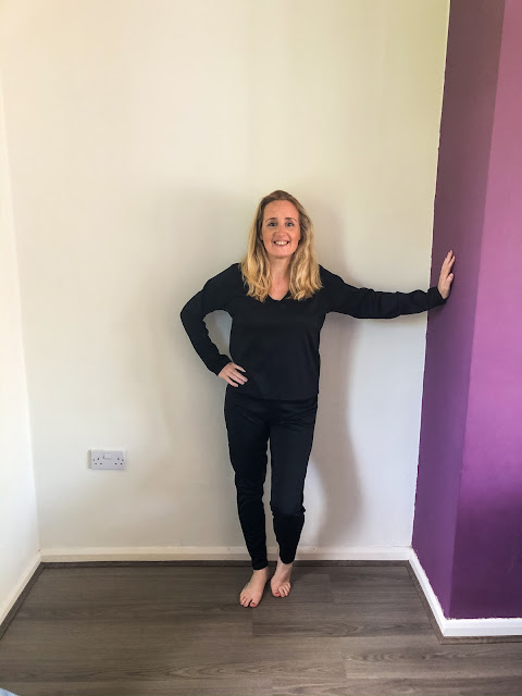 how to wear loungewear past lockdown - Femme Luxe loungewear - standing in black loungewear jogging bottoms and matching sweater
