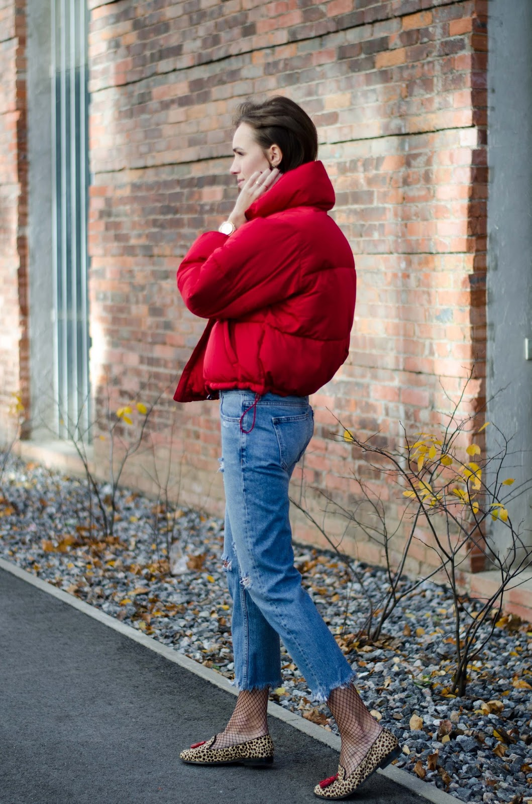 red puffy jacket jeans fall outfit