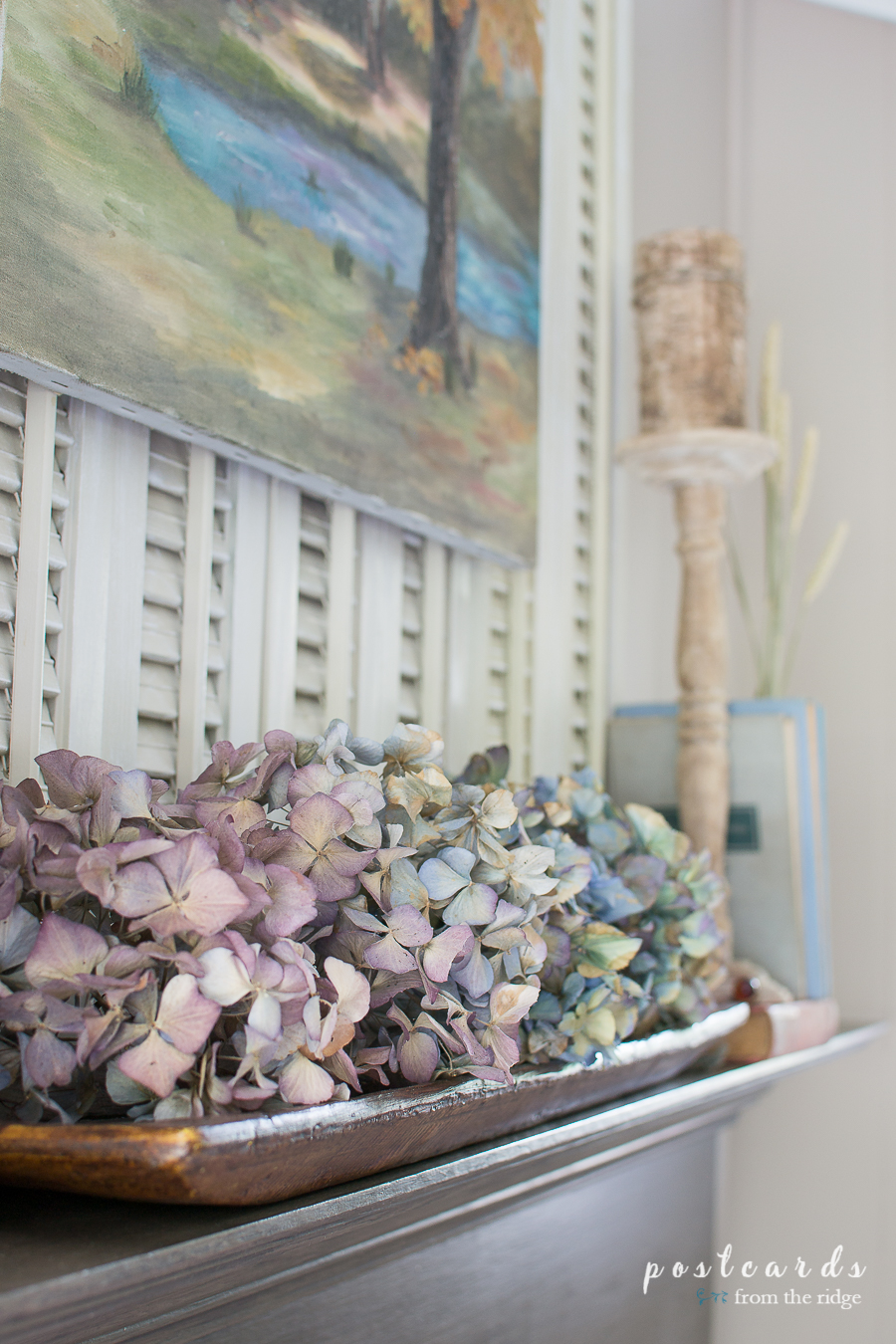 dried hydrangeas on a fireplace mantel