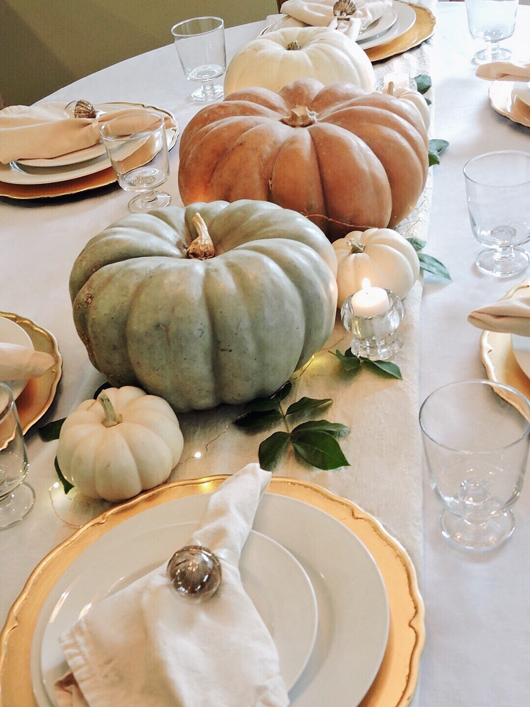 event gathering sugarly thanksgiving table pumpkin fall party planning heirloom fairy lights twinkle candles acorn gold napkin ring target pottery barn