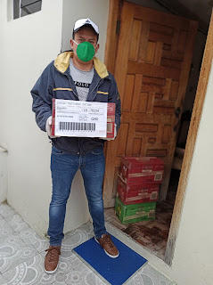 Jonathan Poma doing a delivery in Loja Ecuador