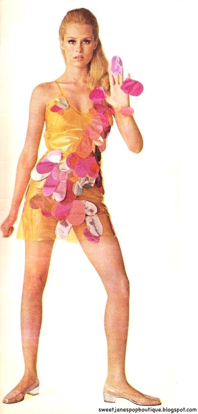 Model Lauren Hutton in a 1960s plastic dress design by Betsey Johnson