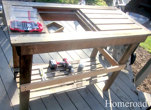 repairing pieces on an old potting table