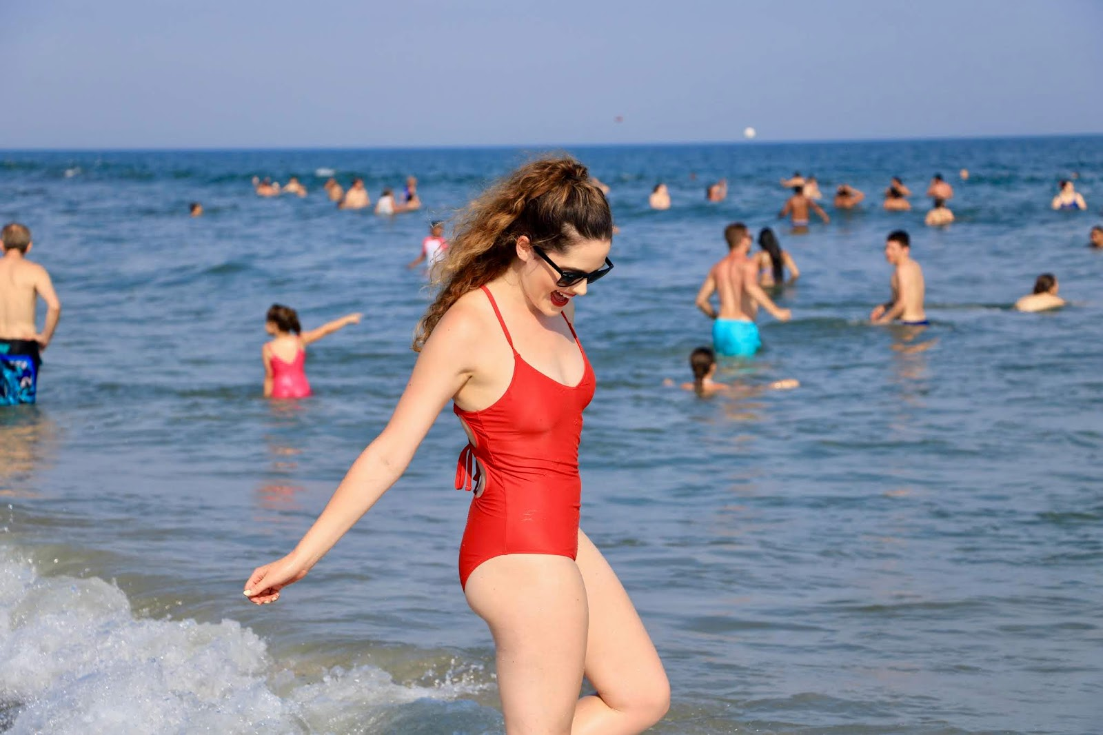 Nyc fashion blogger Kathleen Harper wearing a red Aerie one-piece swimsuit