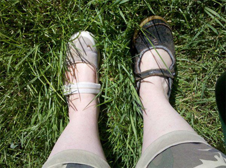 image of my feet in the grass, in mismatched shoes