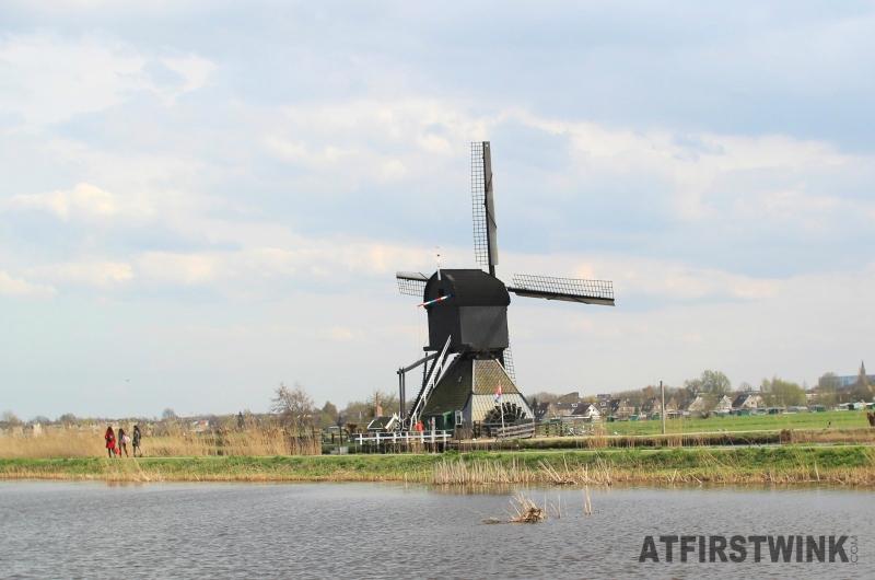 kinderdijk black windmill waterwheel closer