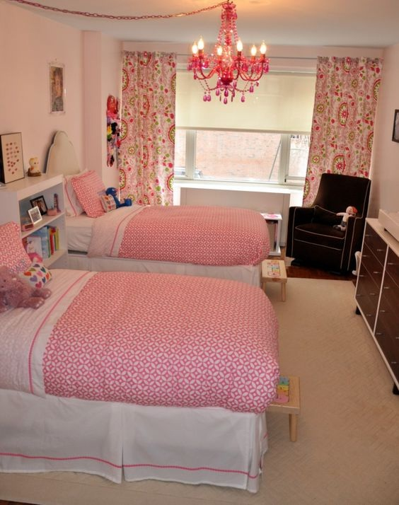 A girly pink bedroom for two adorable sisters
