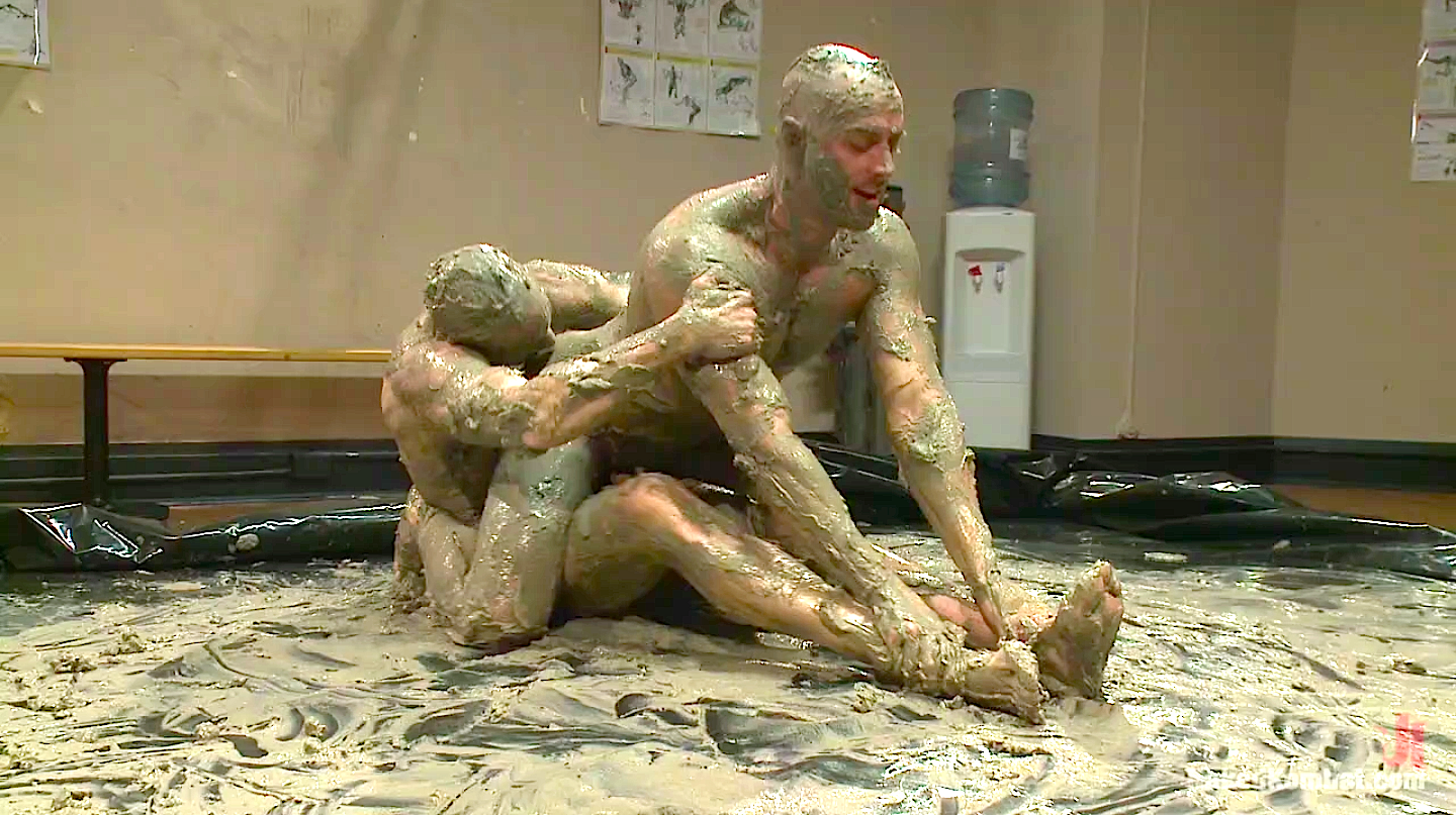 Naked male mud wrestling party