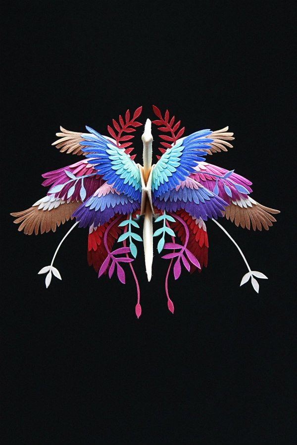 vivid origami crane decorated with hand cut layers of paper