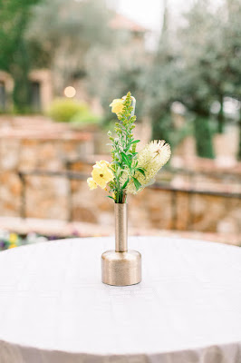 yellow cocktail table flowers