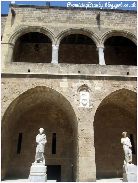 The Palace of the Grand Masters, Rhodes town, Greek islands. The courtyard with statues in archways.