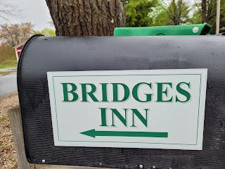 Green lettering on white background - Bridges Inn sign