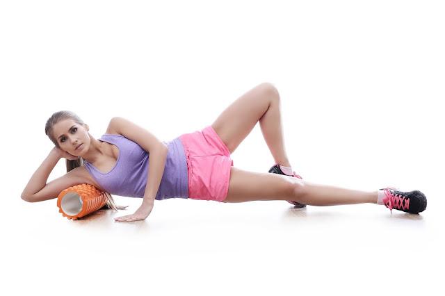 Foam rolling side upper lat muscles for pain relief