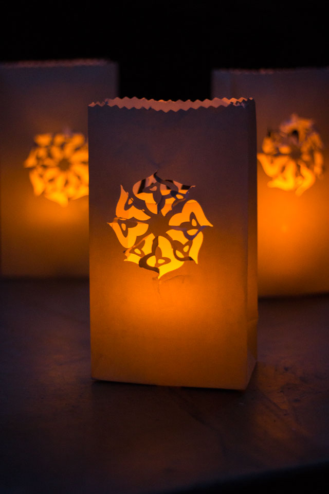 Paper Bag Luminaries - you can make beautiful designs in minutes simply by using a paper punch! || Design Improvised blog