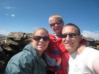 family of 3 hiking in the mountains