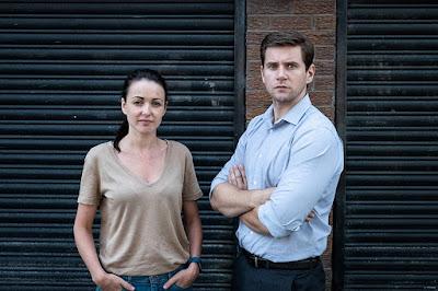 Movie still for Lynsey Miller's 2019 true crime drama Doing Money, starring Karen Hassan and Allen Leech as police detectives