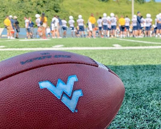 West Virginia University paused all football activities, including workouts and games