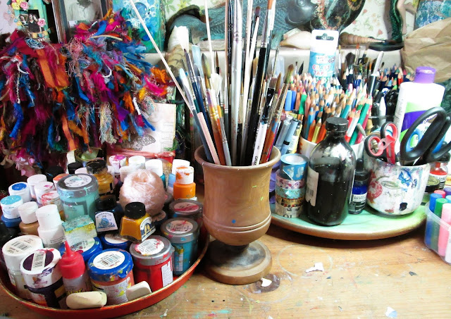 Art supplies and art journals, paint and brushes of Artyshroo, a mixed media artist and illustrator