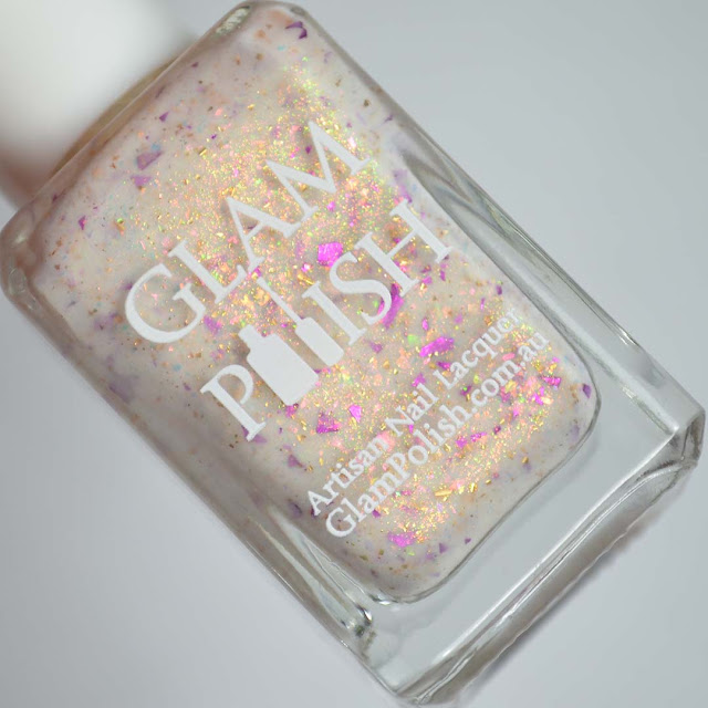 cream nail polish with shimmer in a bottle