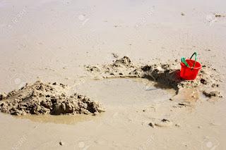 Cavar buraco areia praia