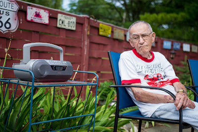 Grandpa listening to a Brewers baseball game.
