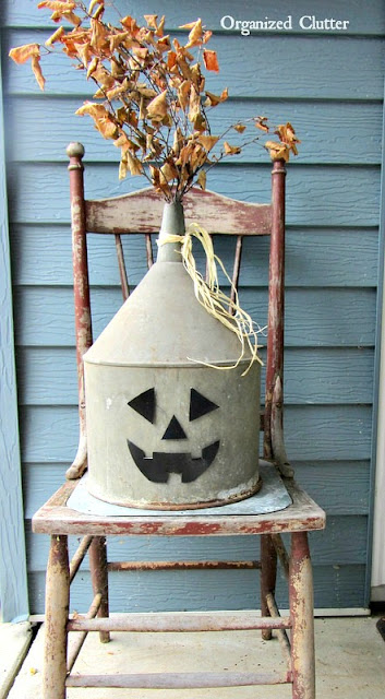 A funnel Jack O Lantern with Metal Face #repurpose #Halloween #fall #autumn