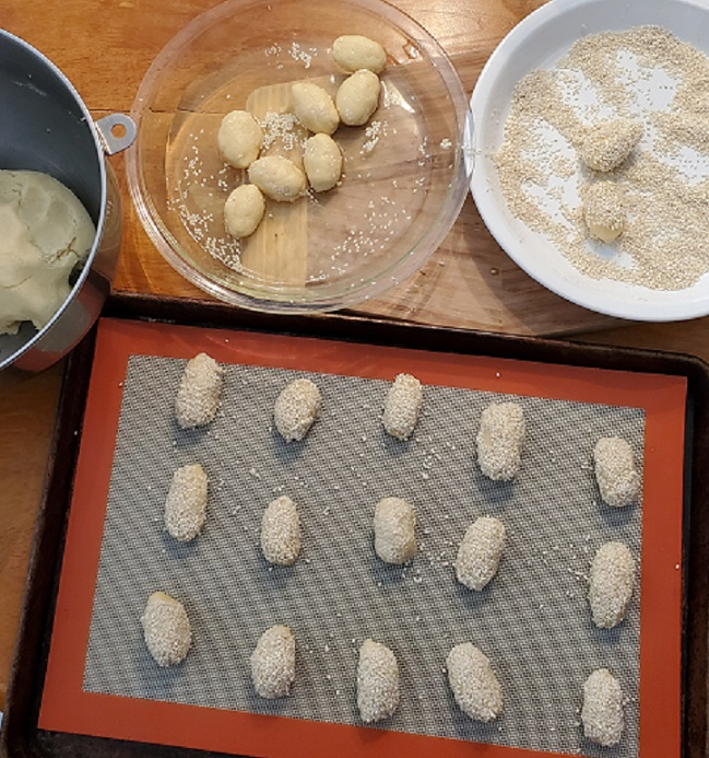 this is a tray of unbaked sesame seeds cookies on a cookies sheet ready to bake